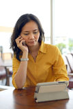 Young Pretty Asian Woman Talking On Phone In Cafe Stock Photo