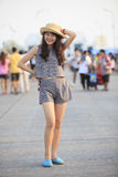 Young and pretty asian woman wearing straw hat standing and post Royalty Free Stock Photography