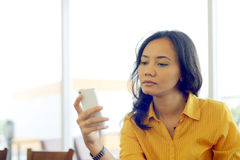 Young Pretty Attractive Asian Woman Texting Her Smartphone Royalty Free Stock Image