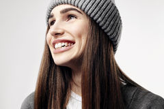 Young pretty beautiful woman in a grey outfit. Closeup portrait of smiling face. Winter clothes. Royalty Free Stock Photography
