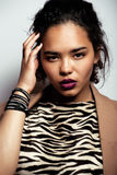 Young pretty black skinned woman. In dress with zebra print Stock Photography