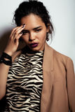 Young pretty black skinned woman. In dress with zebra print Royalty Free Stock Photo