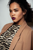 Young pretty black skinned woman. In dress with zebra print Stock Image