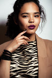 Young pretty black skinned woman. In dress with zebra print Stock Images