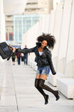 Young pretty black woman jumping Stock Images