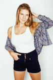 Young pretty blond girl hipster posing frendly Royalty Free Stock Photography