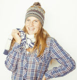 Young pretty blond teenage girl in winter hat and Royalty Free Stock Photo