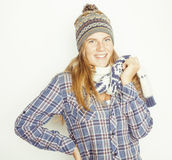 Young pretty blond teenage girl in winter hat and Royalty Free Stock Images