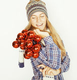 Young pretty blond teenage girl in winter hat and Stock Photos