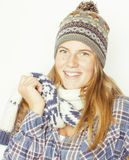 Young pretty blond teenage girl in winter hat and Royalty Free Stock Photography