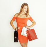 Young pretty blond woman with bags on Christmas Royalty Free Stock Photography