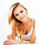Young pretty blond woman in bed covered white sheets smiling che. Erful sexy look close up, happy morning concept, lifestyle people Royalty Free Stock Images