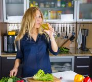 Young pretty blond woman cooking Stock Image
