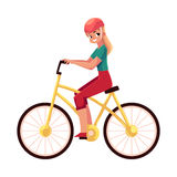 Young pretty blond woman, girl riding a bicycle, cycling Stock Images