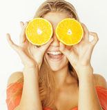Young pretty blond woman with half oranges close Stock Photos