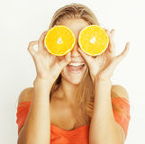 Young pretty blond woman with half oranges close up isolated on white bright teenage smiling Stock Photos