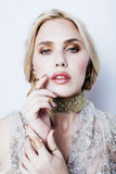 Young pretty blond woman in luxury jewelry, lifestyle rich people concept Royalty Free Stock Images