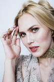 Young pretty blond woman in luxury jewelry, lifestyle rich people concept Royalty Free Stock Photos