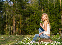 Young pretty blond woman on a meadow with flowers Stock Images