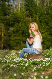 Young pretty blond woman on a meadow with flowers Royalty Free Stock Image