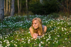Young pretty blond woman on a meadow with flowers. Young pretty blond woman on a meadow Royalty Free Stock Photography