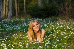 Young pretty blond woman on a meadow with flowers. Young pretty blond woman on a meadow Stock Images