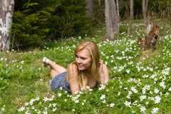 Young pretty blond woman on a meadow Stock Photography