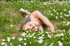 Young pretty blond woman on a meadow flowers. Young pretty blond woman on a meadow with flowers Royalty Free Stock Photography