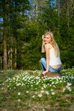 Young pretty blond woman on a meadow flowers. Young pretty blond woman on a meadow with flowers Stock Image