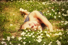 Young pretty blond woman on a meadow flowers Royalty Free Stock Photo