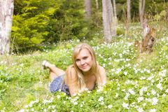 Young pretty blond woman meadow spring flowers. Young pretty blonde woman on a meadow with spring flowers Stock Images