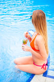 Young pretty blond woman in a orange bikini and sunglasses enjoy Royalty Free Stock Image