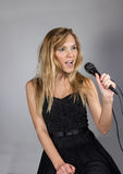 Young pretty blond woman sing Stock Photo
