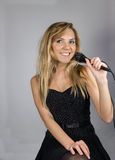 Young pretty blond woman sing Royalty Free Stock Photography