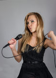 Young pretty blond woman sing Stock Photos