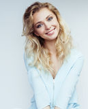 Young pretty blond woman smiling on white Stock Photo