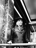 Young pretty blond woman in stylish hat, street fashion european Royalty Free Stock Image