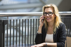 Young pretty blond woman talking on a cell phone. Royalty Free Stock Photo
