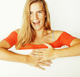 Young pretty blond woman thinking showing to copyspace isolated Stock Photos