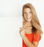 Young pretty blond woman thinking showing to copyspace  on white close up Stock Image