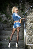Young Pretty Blond Woman in Trendy Denim Fashion Outdoor Royalty Free Stock Photography