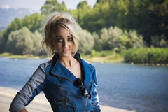 Young Pretty Blond Woman in Trendy Denim Fashion Outdoor Stock Photography