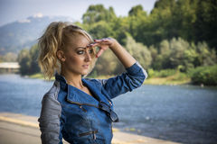 Young Pretty Blond Woman in Trendy Denim Fashion Outdoor Stock Image