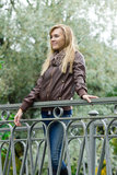 Young pretty blond woman waking in park Royalty Free Stock Photos