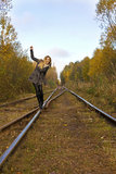 Young pretty blond woman walking near railway Stock Photos