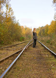 Young pretty blond woman walking near railway Stock Image