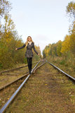 Young pretty blond woman walking near railway Stock Images