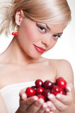 Young pretty blonde with cherries stock photos