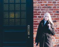 Girl Near The Door royalty free stock photo