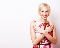 Young pretty blonde girl presenting something at white copy spac Stock Image